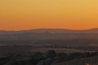 Siena al tramonto vista dall Crete Senesi